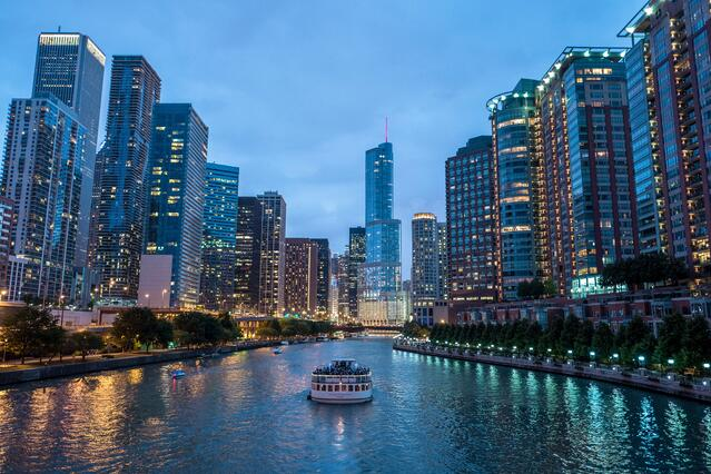 Chicago Riverwalk Illuminated At Twilight with Boat.jpg