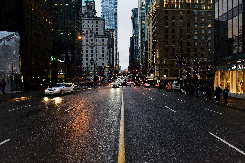 Downtown-Denver-Street-With-Cars-Headlights.jpg
