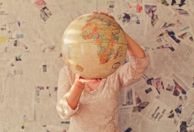 Person_holding_globe_by_Slava-Bowman.jpg