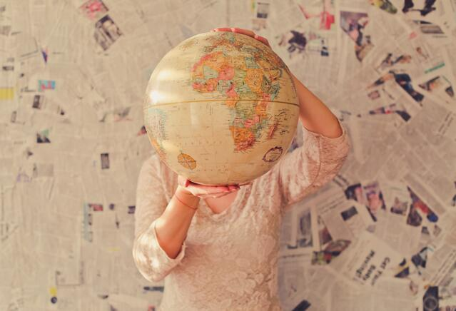 Person_holding_globe_by_Slava-Bowman.jpg