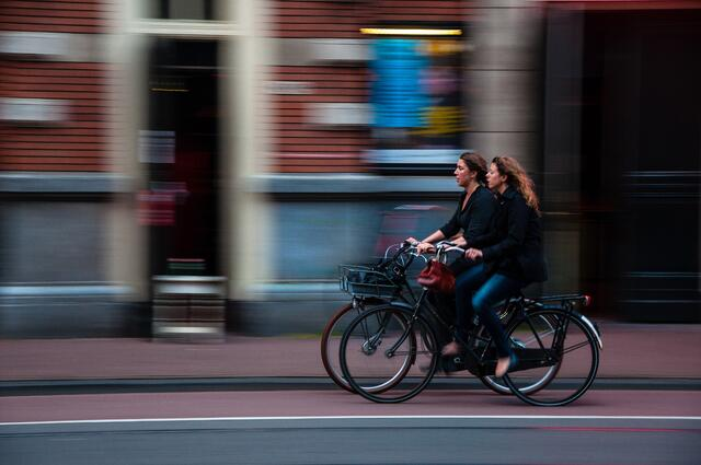 Two-women-bicycling-in-city.jpg
