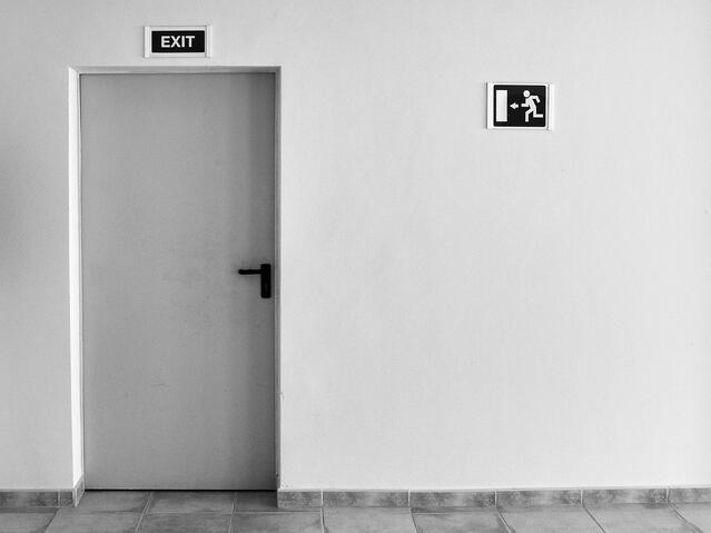 White_wall_and_exit_door_by_michael_jasmund