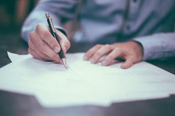 blue-shirt-signing-paper-356x237.jpg