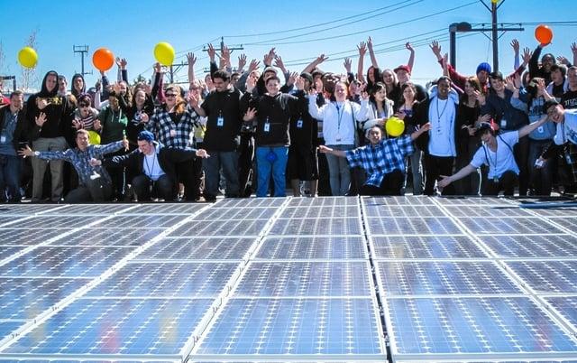 students_and_solar_panels_community_solar.jpg