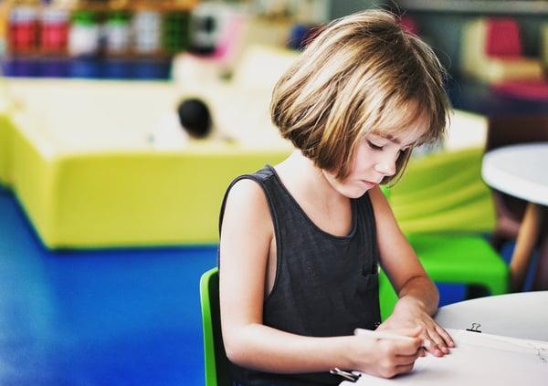 Girl-Drawing-At-Desk_pan-xiaozhen