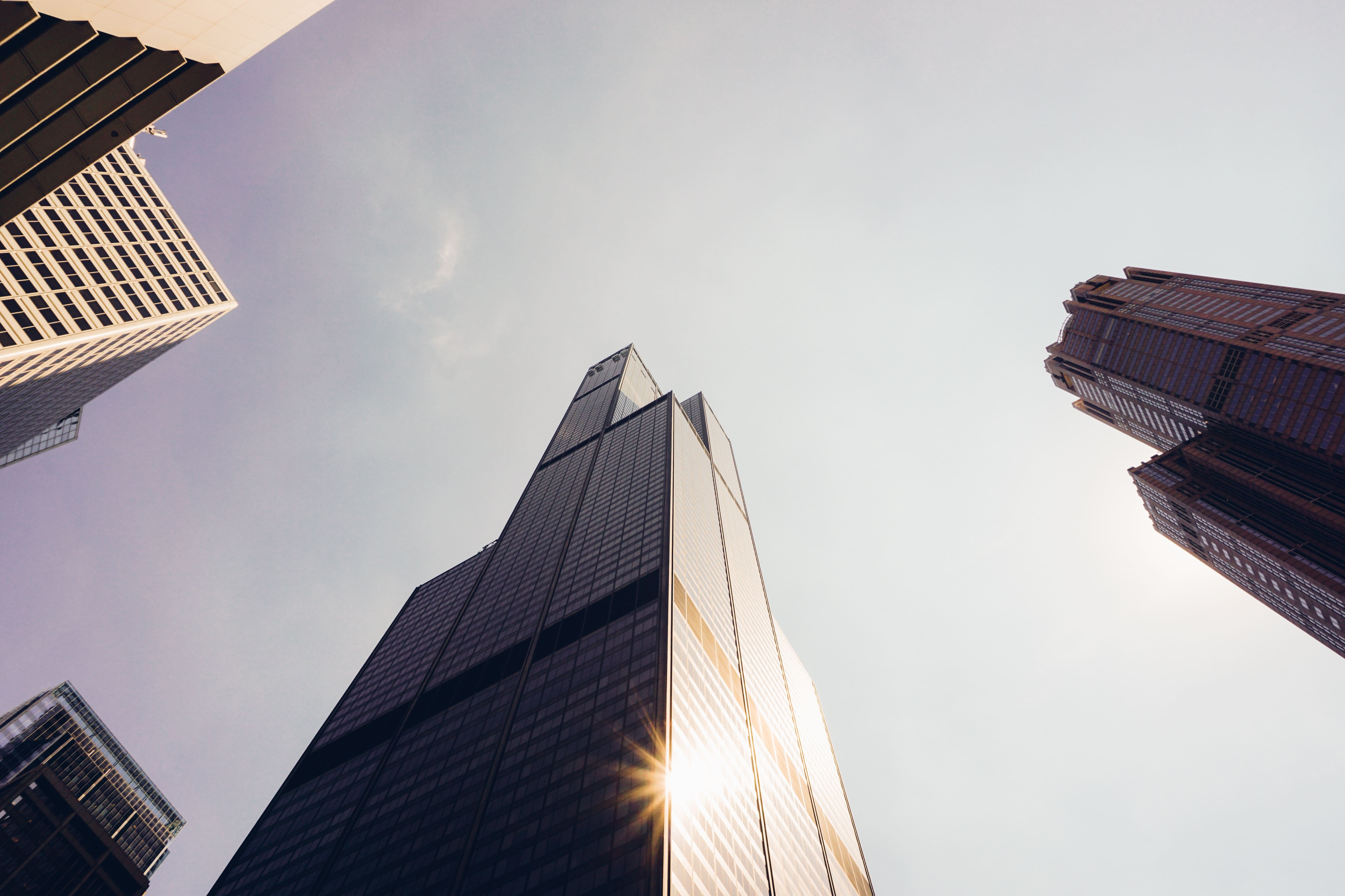 willis-tower-upward-view-with-sun-flare